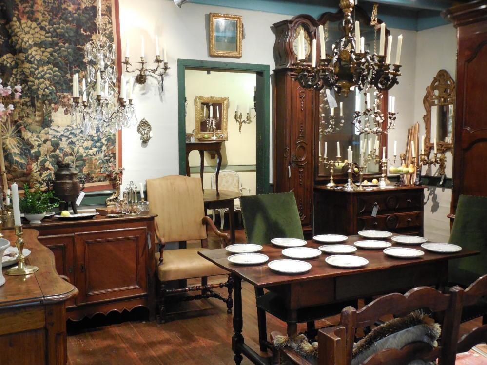 View inside Au Vieux Paris Antiques showcasing seating, tables, porcelain, lighting, case pieces, mirrors, art and clocks