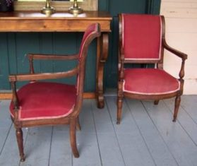 Pair of red arm chairs