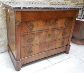 Three drawer Louis Phillipe walnut commode with St. Anne marble top and original bronze doré hardware.