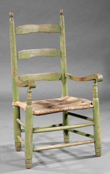 Cowhide armchair with green and yellow patena