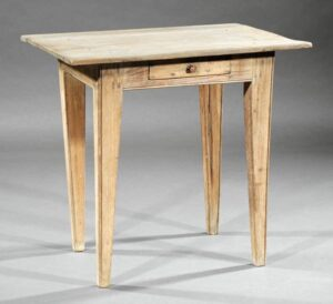 Cypress table with beading on its skirt as well as its legs.