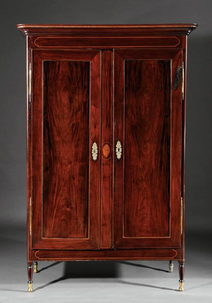 Mahogany armoire with carved eagle inlay.