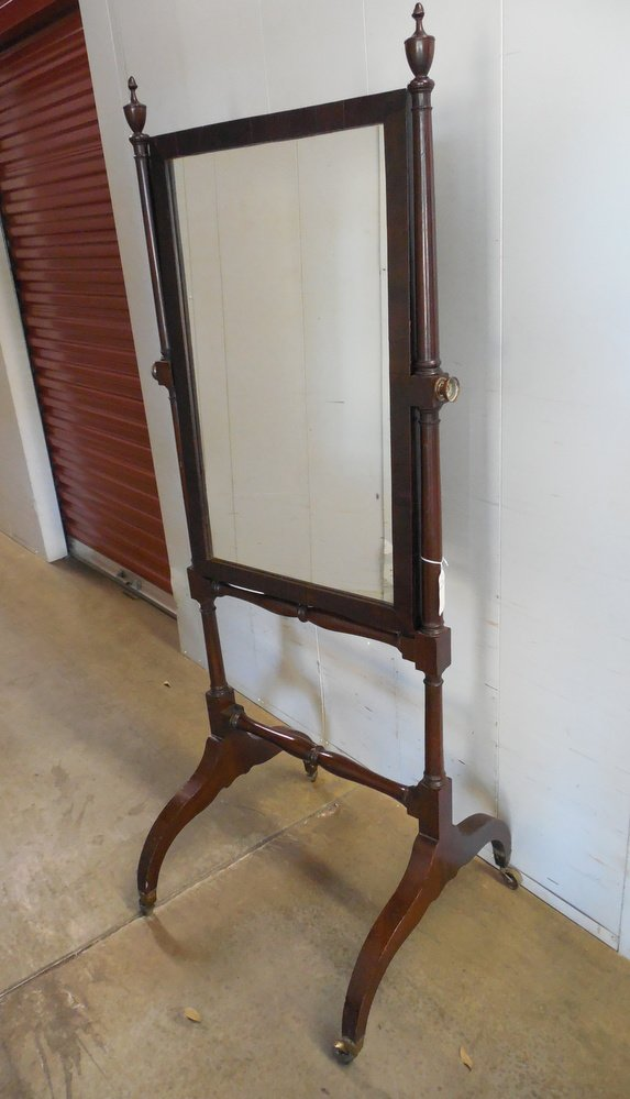 Cheval mirror with Campeche legs and tall slender posts.