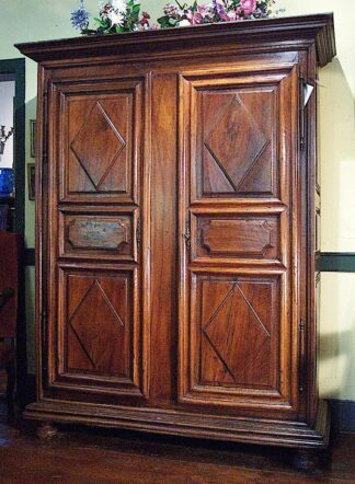 Louis XIII style walnut armoire from the Languadoc region of France, circa 1700.