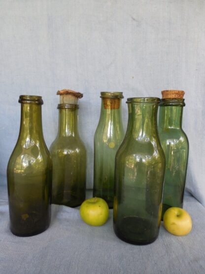 Green Glass Bottles in glass circa
