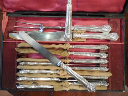 Loaded Silver-handed Knives in silver circa