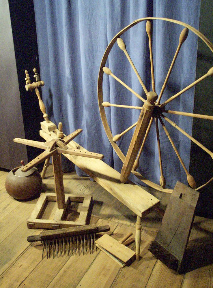 Rare tall spinning wheel found in Louisiana and an assortment of spinning tools.