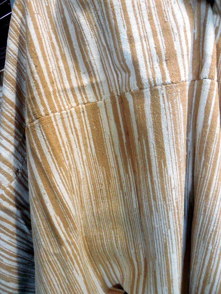 Acadian blanket woven with brown & white cotton spun alternately.