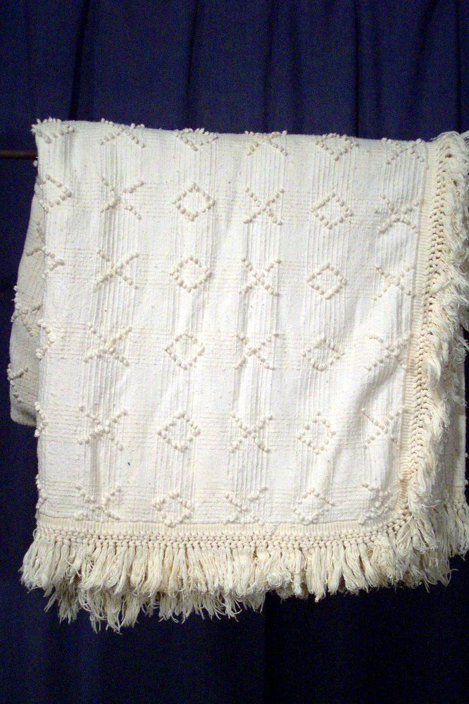 Coverture de mariage woven by Mme. Dronet, a renowned weaver.
