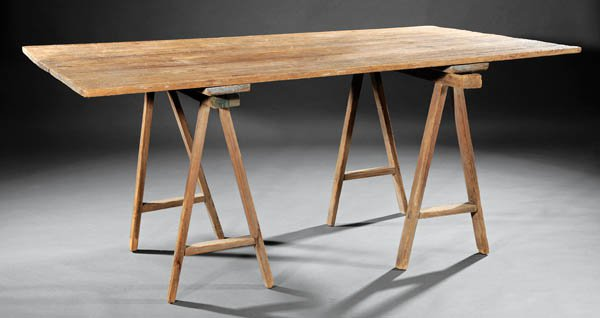 Cypress treteaux table, large plank top with sawhorse like legs.