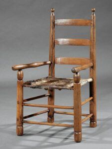 Cowhide armchair with pecan finish.